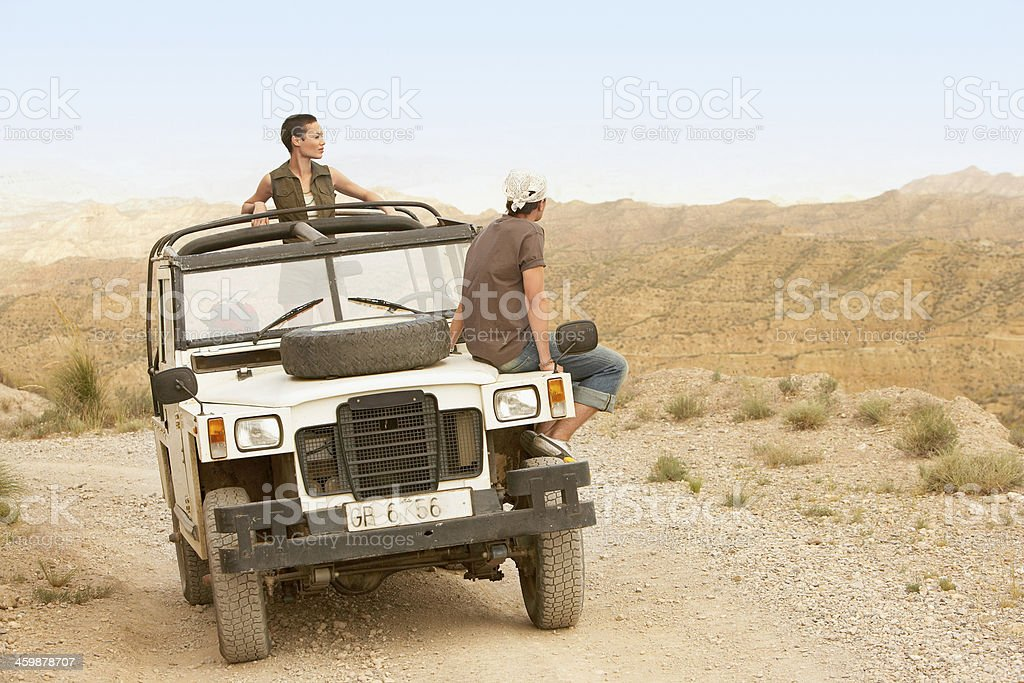 Couple In Four-Wheel-Drive Car royalty-free stock photo