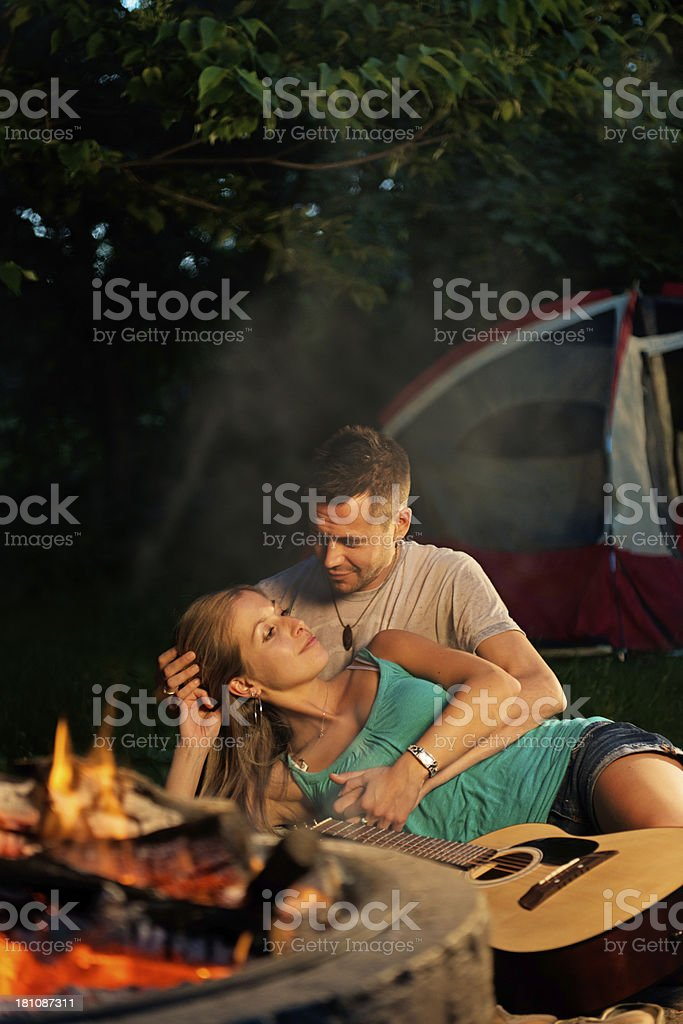 Couple in front of a fire royalty-free stock photo