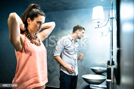 istock couple in front of mirror before the night out 488221408