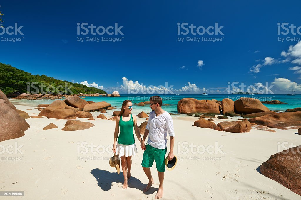 Couple in green on a beach at Seychelles royalty-free stock photo