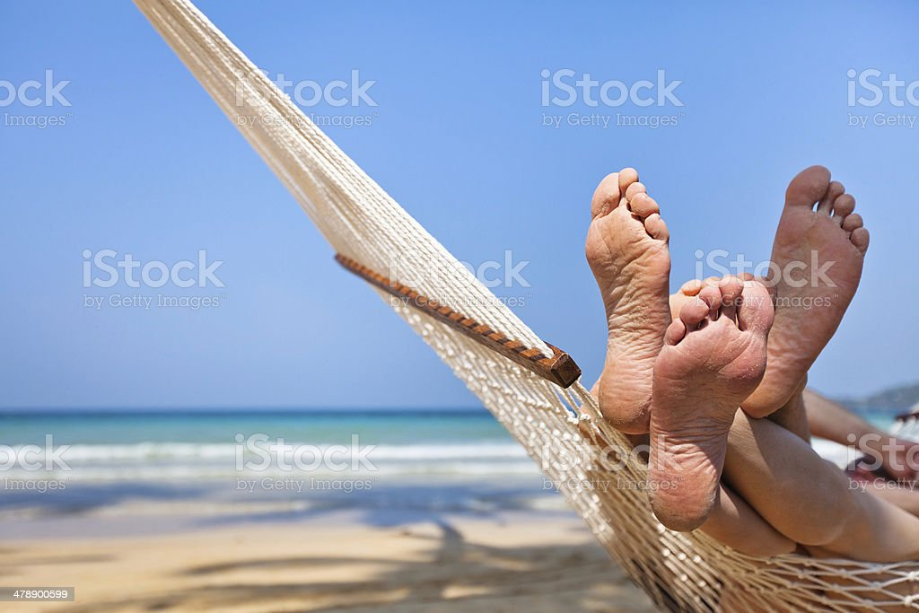 couple in hammock on the beach royalty-free stock photo