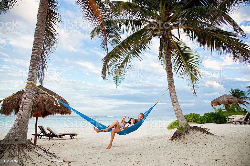 Couple in hammock on vacation stock photo