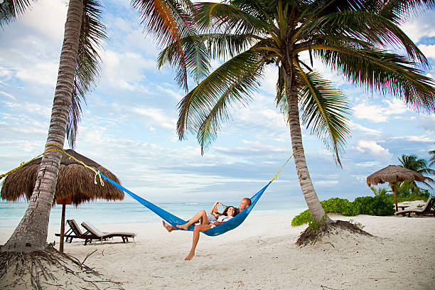 Couple in hammock on vacation  honeymoon stock pictures, royalty-free photos & images