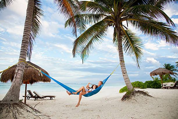 couple in hammock on vacation - smekmånad bildbanksfoton och bilder