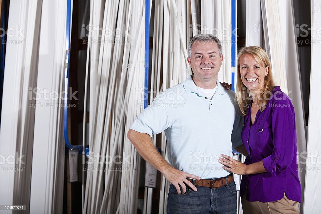 Couple in hardware store lumber aisle stock photo