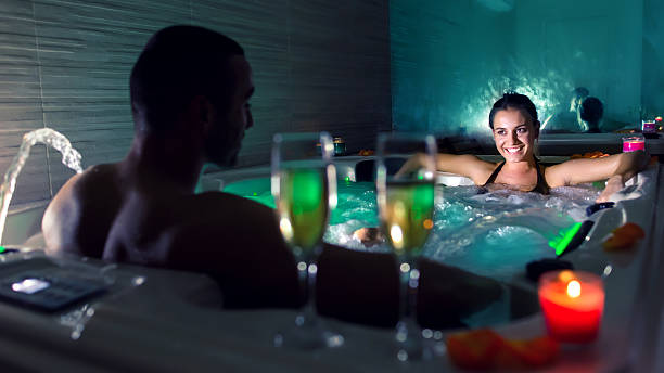 couple in hot tub pool - bad date stockfoto's en -beelden