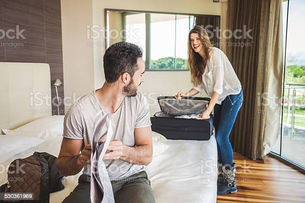 Couple in hotel room getting dressed picture id530361969?b=1&k=6&m=530361969&s=612x612&h=ona6bkj6ofhrzbhia7 kxc8gxe9yxukcn2ti3wkn bk=