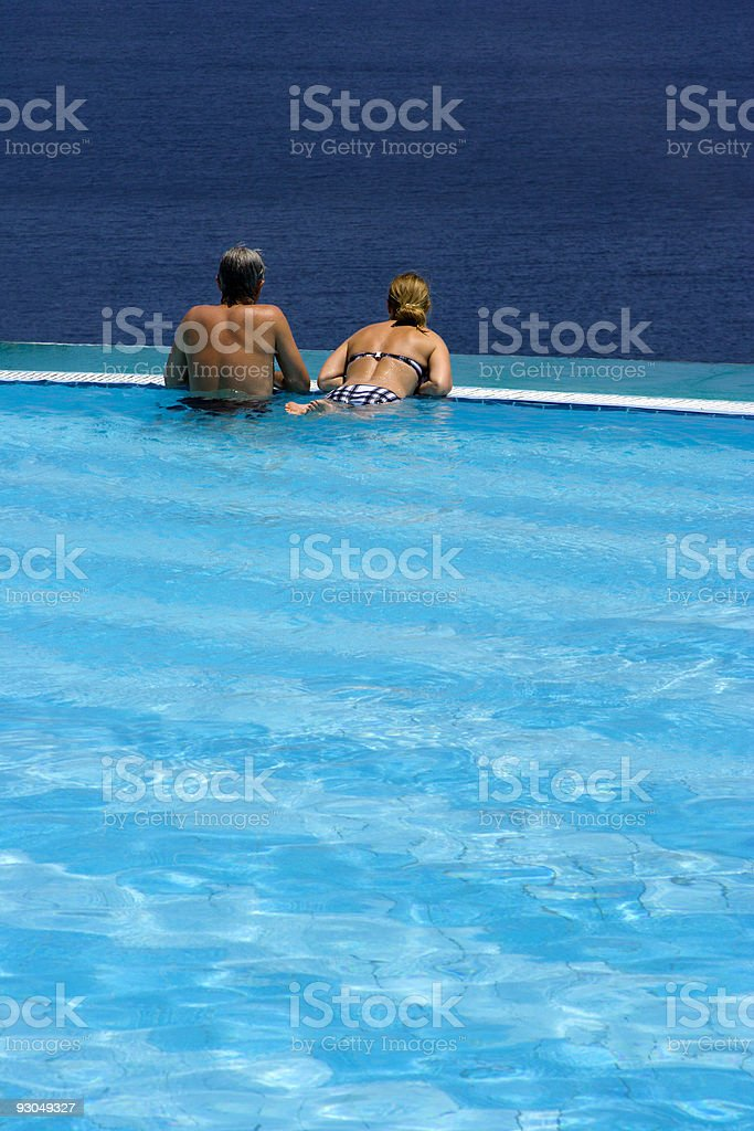Couple in infinity pool royalty-free stock photo