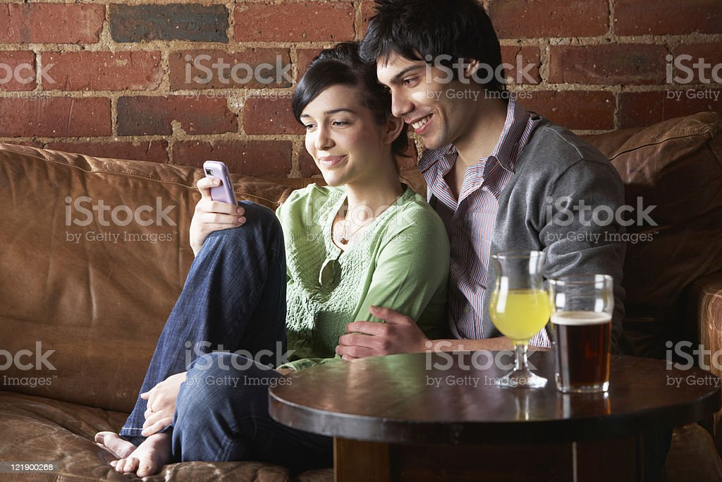 Couple in love at Cafe using phone royalty-free stock photo