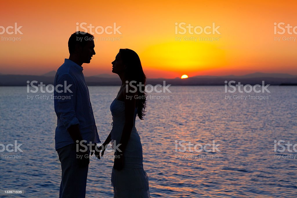 couple in love back light silhouette at lake sunset royalty-free stock photo
