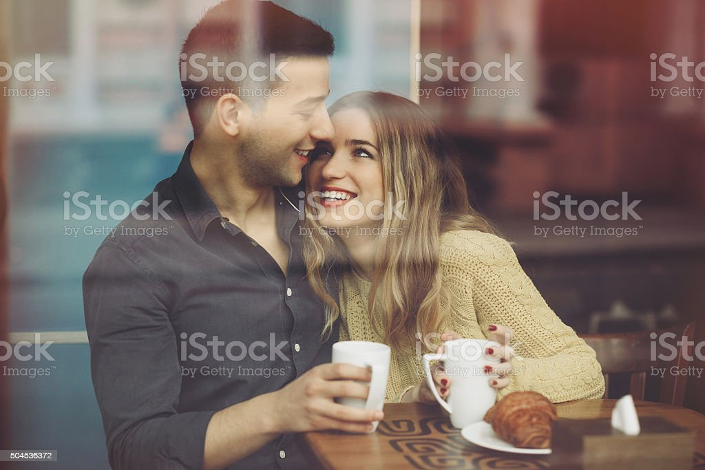 Couple in love drinking coffee in coffee shop stock photo