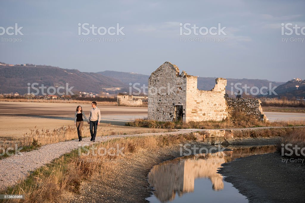 Couple in love engagement day walk in romantic natural park stock photo