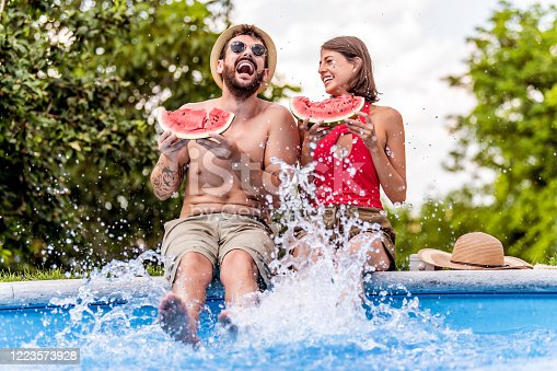 Couple in love enjoying in swimming pool.People,love,travel and vacation concept.