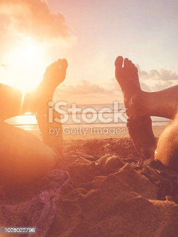 istock Couple in love enjoying on the tropical sandy beach. 1028022796
