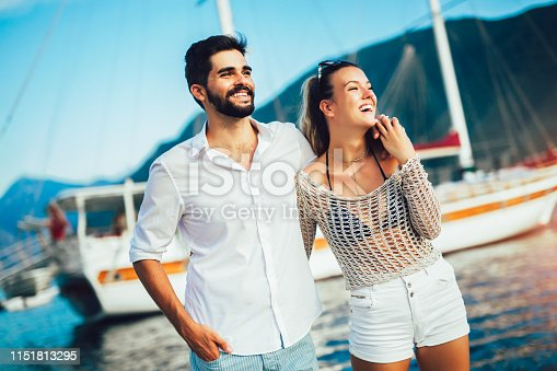 Couple in love, enjoying the summer time by the sea.