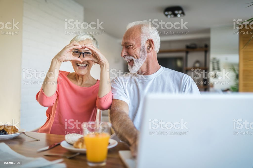 Couple in love enjoying their time during breakfast royalty-free stock photo