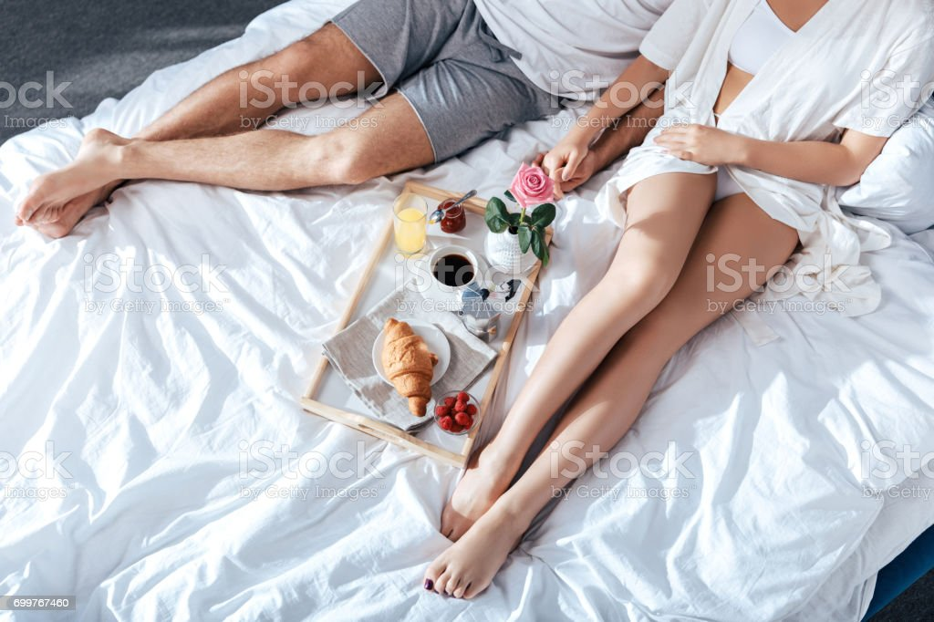 couple in love having breakfast in bed stock photo