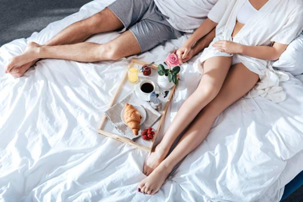 couple in love having breakfast in bed stock photo