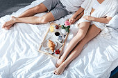 couple in love having breakfast in bed