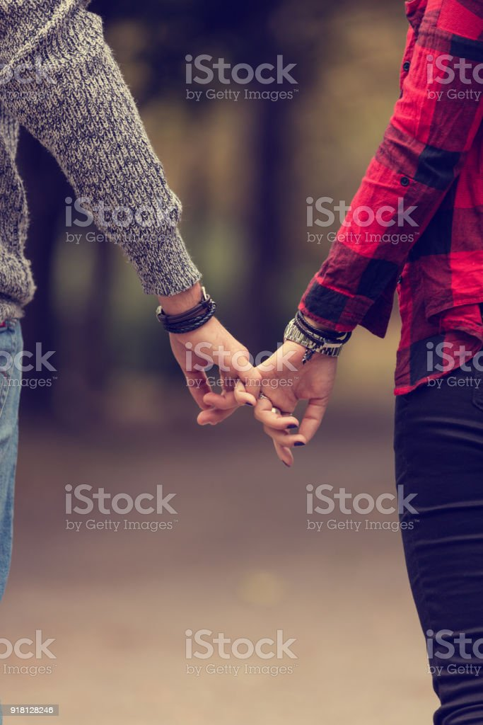 Couple in love holding hands. Love concept. stock photo