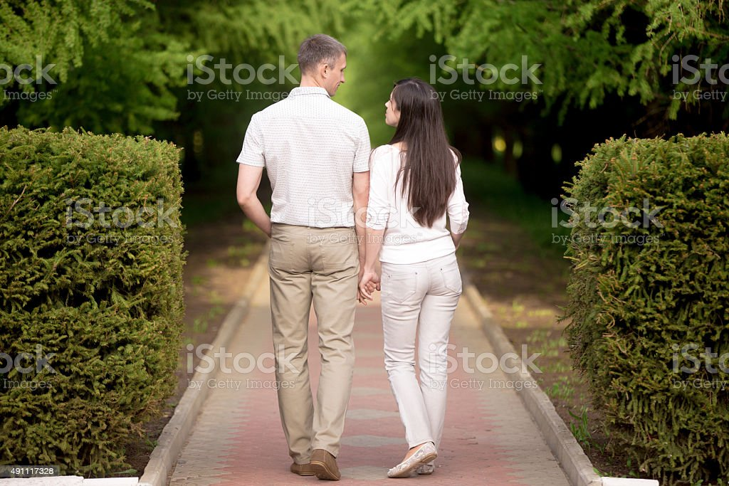 Couple in love holding hands stock photo