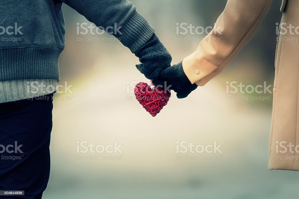 Couple in love holding hearts. stock photo