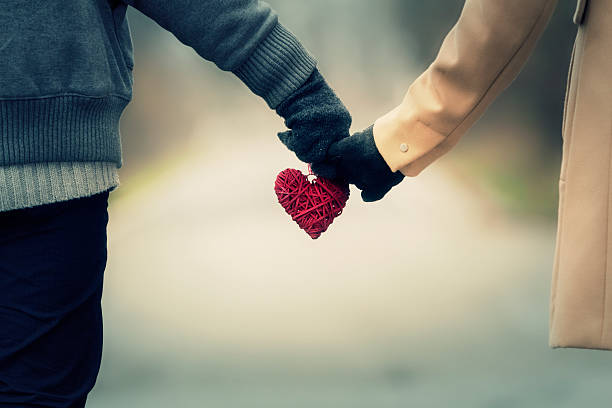 couple in love holding hearts. - styles stock photos and pictures