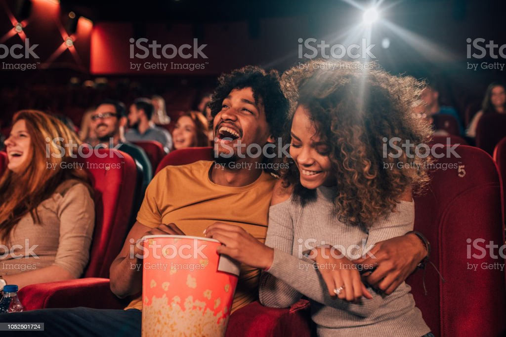 Couple in love hugging at cinema royalty-free stock photo