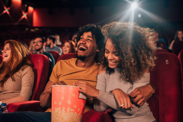 Couple in love hugging at cinema stock photo