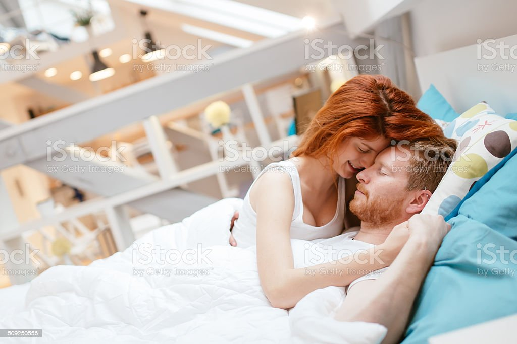 Couple In Love Hugging Kissing In Bed Royalty Free Stock Photo