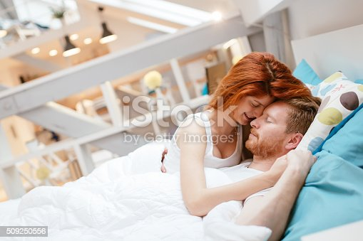 istock Couple in love hugging kissing in bed 509250556