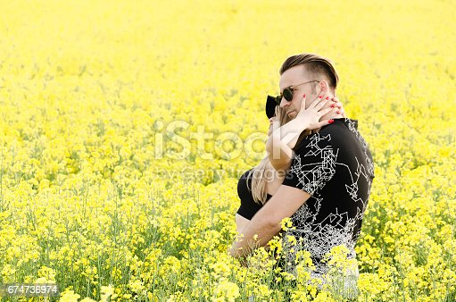 istock couple in love husband and wife enjoyed in the flowers field outdoors 674736974