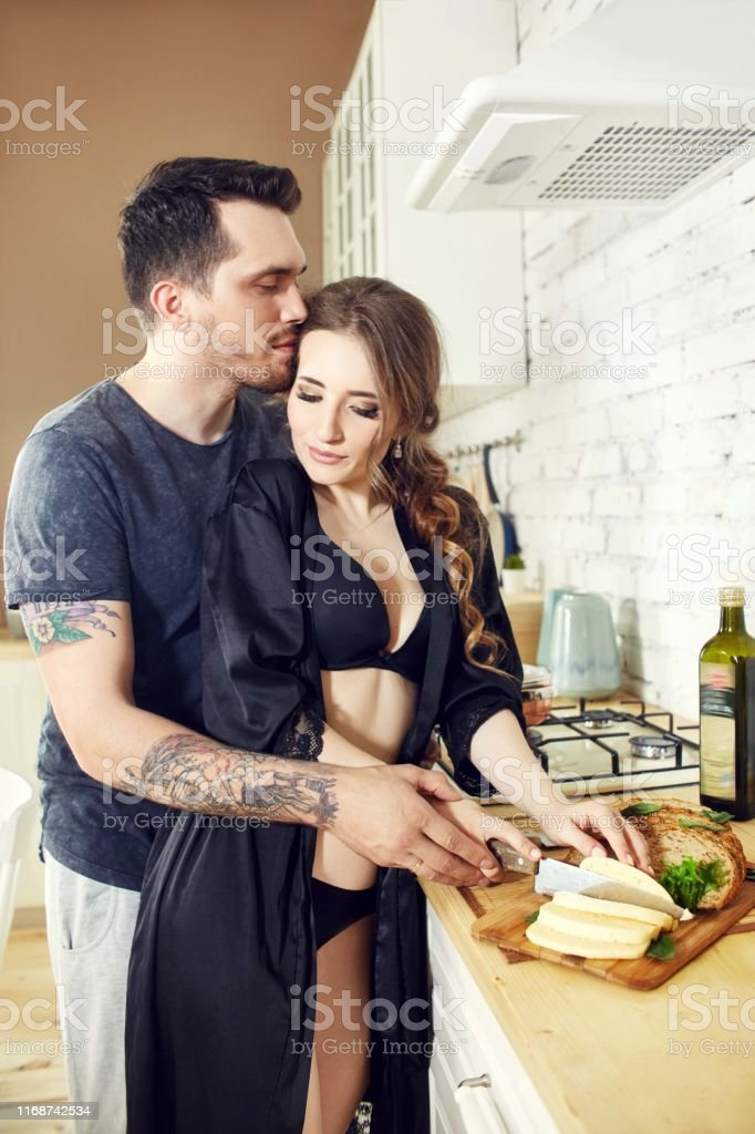 Couple In Love In The Kitchen In The Morning Hugs And Prepares Breakfast Happy Family Life Joy And Smiles On The Face Of Men And Women Love And Relationships Stock Photo