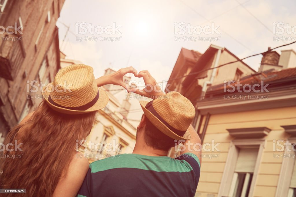 Couple in love make heart-shape with hands. Love concept. stock photo