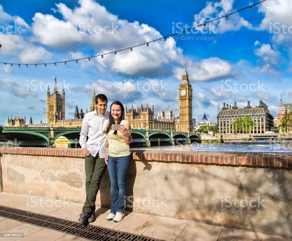 happy couple taking selfie picture in the travel in London