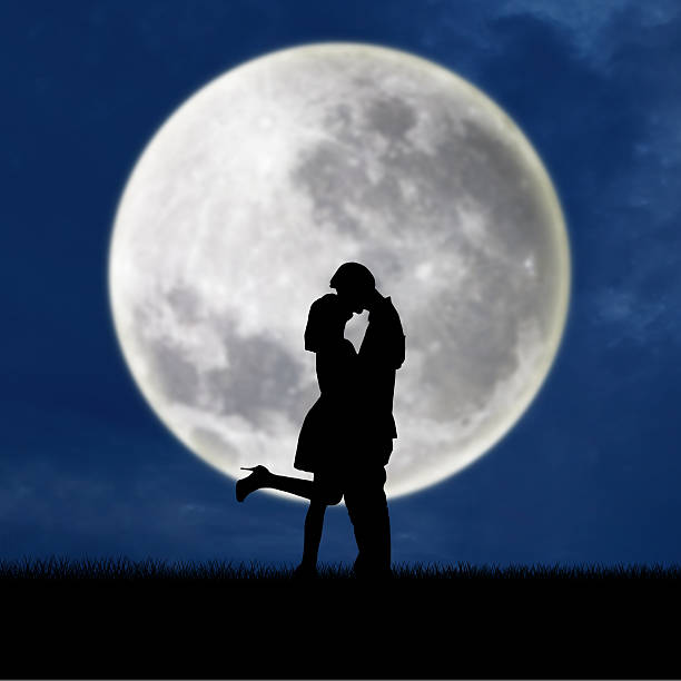 couple in love on blue full moon silhouette - romantic moon stock photos and pictures