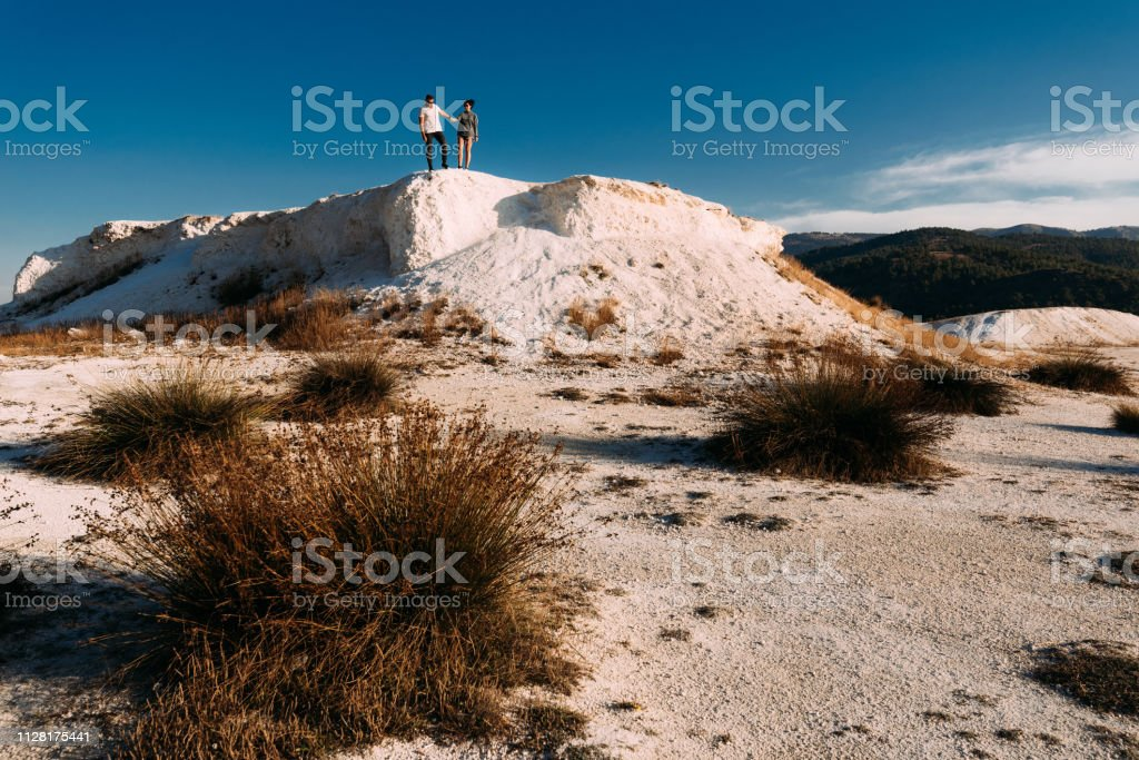 A couple in love on the hill admires the beautiful views. Man and...
