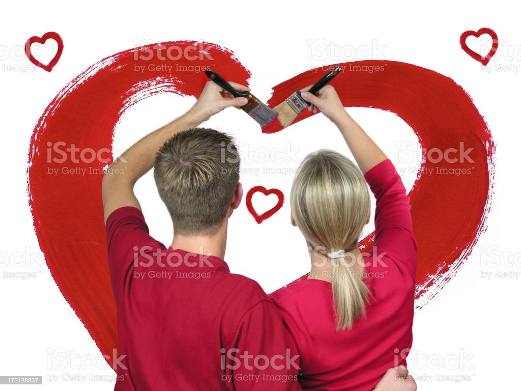 Couple in love painting a red heart royalty-free stock photo