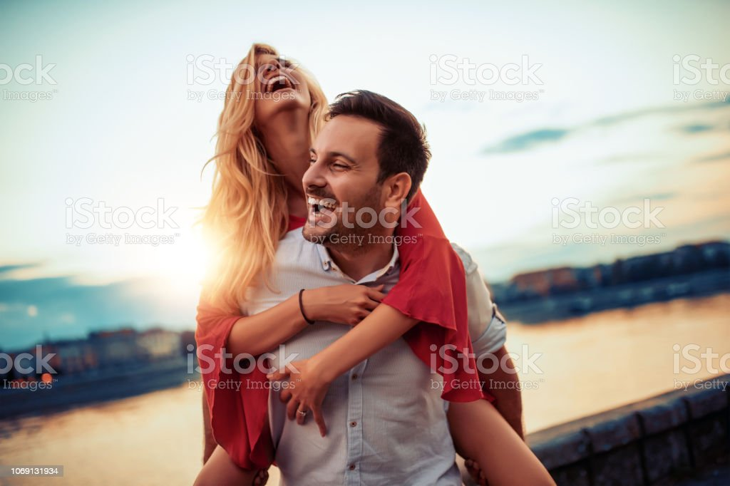 Couple in love Happy young couple having fun outdoors. 20-29 Years Stock Photo