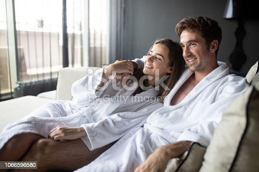 610769340istockphoto Couple in love relaxing and enjoying wellness weekend 1066596580
