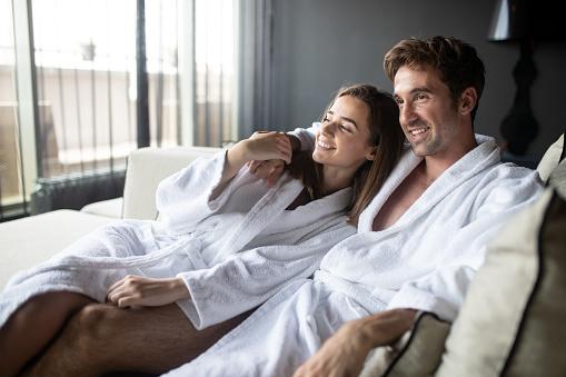 610769340 istock photo Couple in love relaxing and enjoying wellness weekend 1066596580