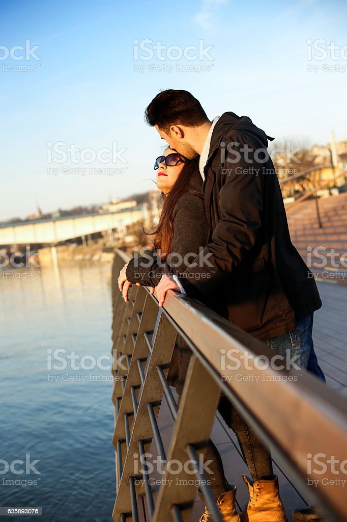 Couple in love relaxing on the bridge near the river stock photo