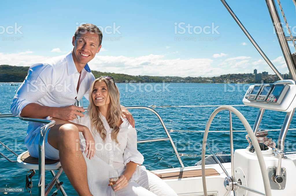 Couple in love sailing on a yacht stock photo