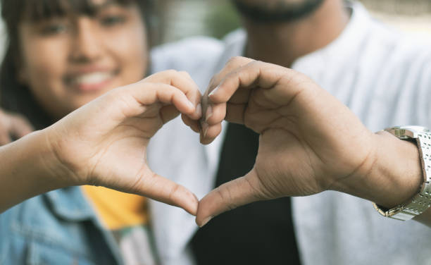 Couple in love showing heart with their hands - Concept of happy couple relationship and togetherness Couple in love showing heart with their hands - Concept of happy couple relationship and togetherness. romance stock pictures, royalty-free photos & images