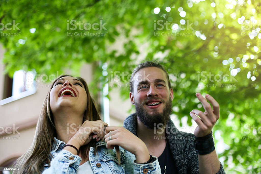 Couple in love - sitting together and smiling. stock photo