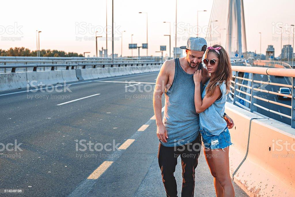 Couple on bridge sex