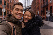 man and woman taking a selfie in the city of New York