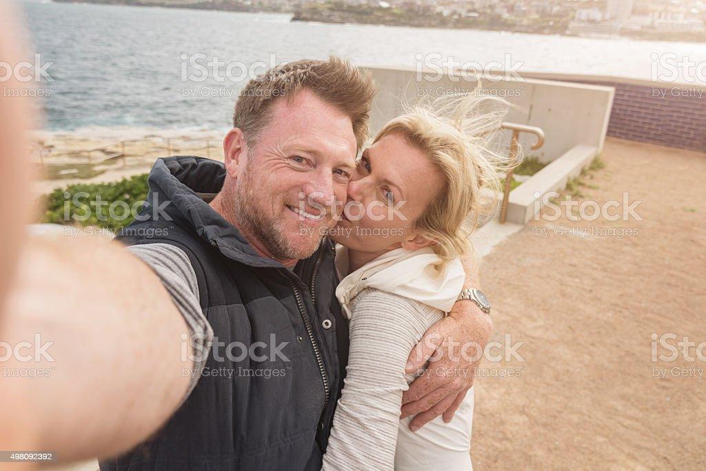 Couple in Love Taking Selfie Kissing Bondi Beach Australia stock photo