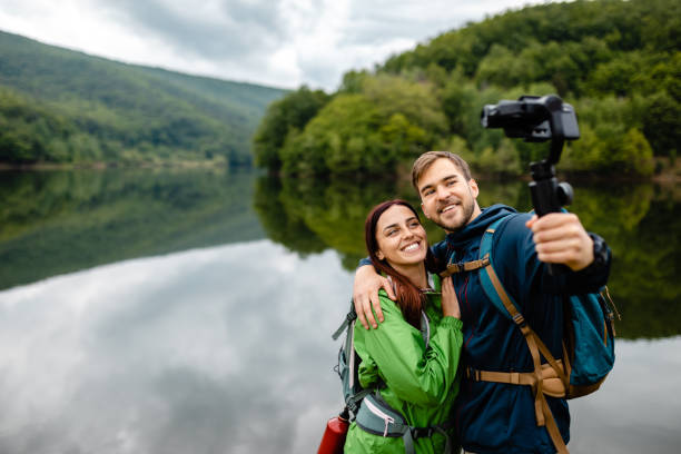 Couple in love taking selfie so they can remember this moment forever stock photo
