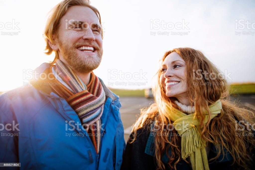 Couple in Love Waking Along the Coast stock photo
